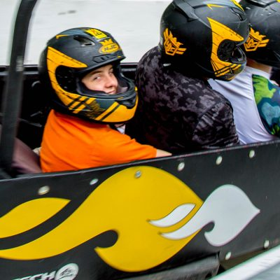 Passengers on a bobsled ride